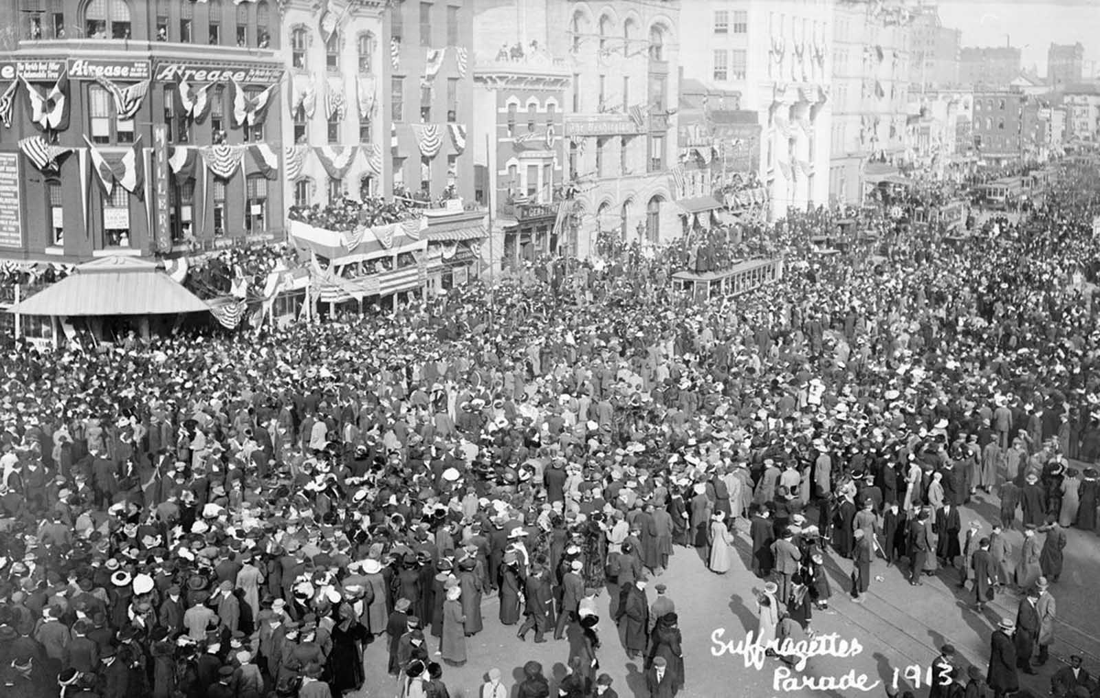 Crowds press in on the parade route in Washington, District of Columbia, on March 3, 1913. The stands and bunting were in place for the Inauguration of President Woodrow Wilson, scheduled for the following day.