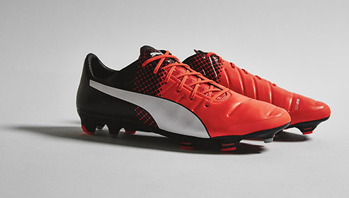 Puma-evoPOWER-1.3-with-Shocking-Orange-Black-and-White-1