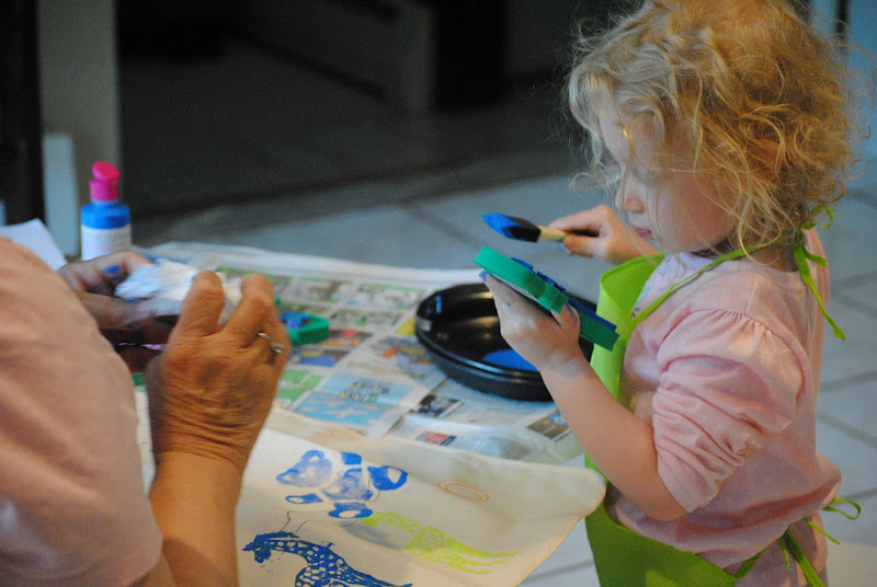 Little girl and her grandma stamping together