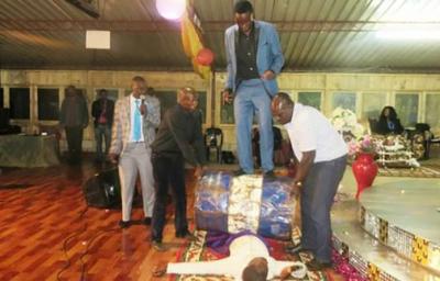 Zimbabwean prophet heals people while rolling drum on them