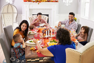 Photo of a family around the Thanksgiving table