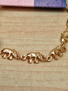 Close up detail of the individual elephants on the bracelet