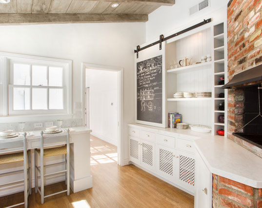 image result for white kitchen with sliding barn door with chalkboard to conceal shelves