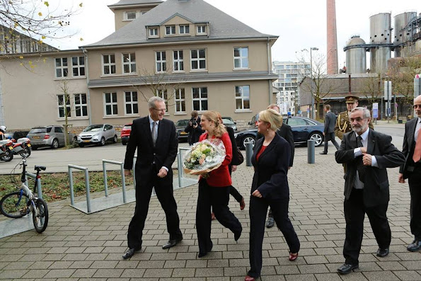 Grand Duchess Stephanie visited Belval Campus in Luxembourg University. Princess Stephanie style Prada clutch bag, wore Prada red jacket