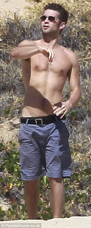 Chace Crawford goes shirtless to play ball on the beach in ...