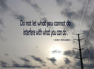 "A grey, mostly cloudy sky with powerlines running along the right side of the picture. The words, in black font, are ""Do not let what you cannot do interfere with what you can do - John Wooden"""