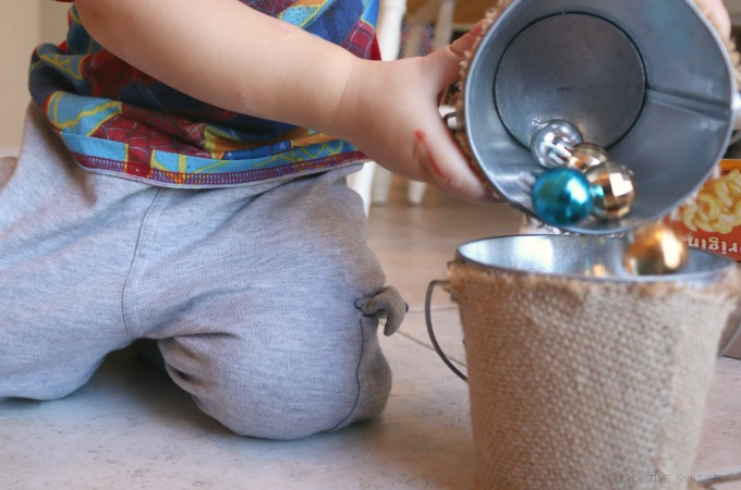 pouring christmas bulbs for fine motor skills development