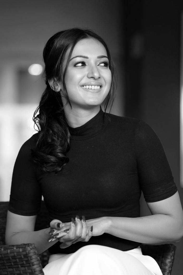 Catherine Tresa Grogreous Stills in Black Top and White Pant