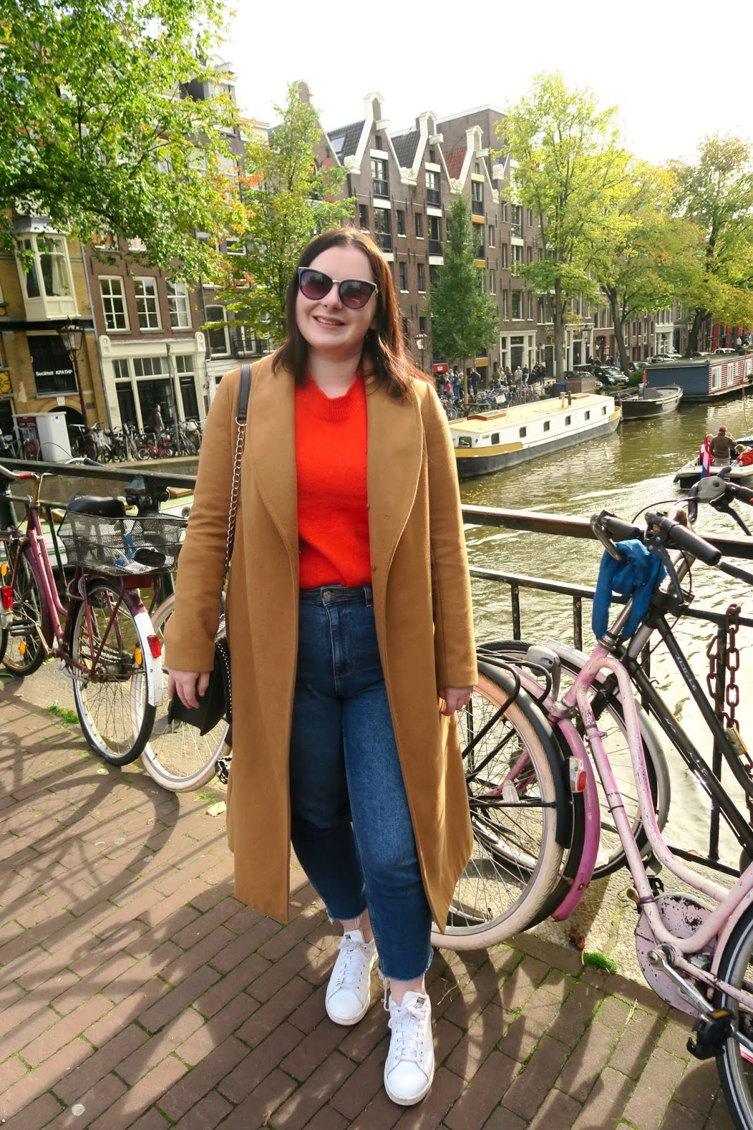 4 Days in Amsterdam- pose on Amsterdam canal bridge