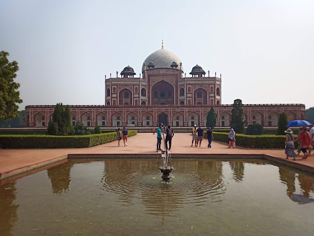 View of Humayun's tomb building from behind water fountain