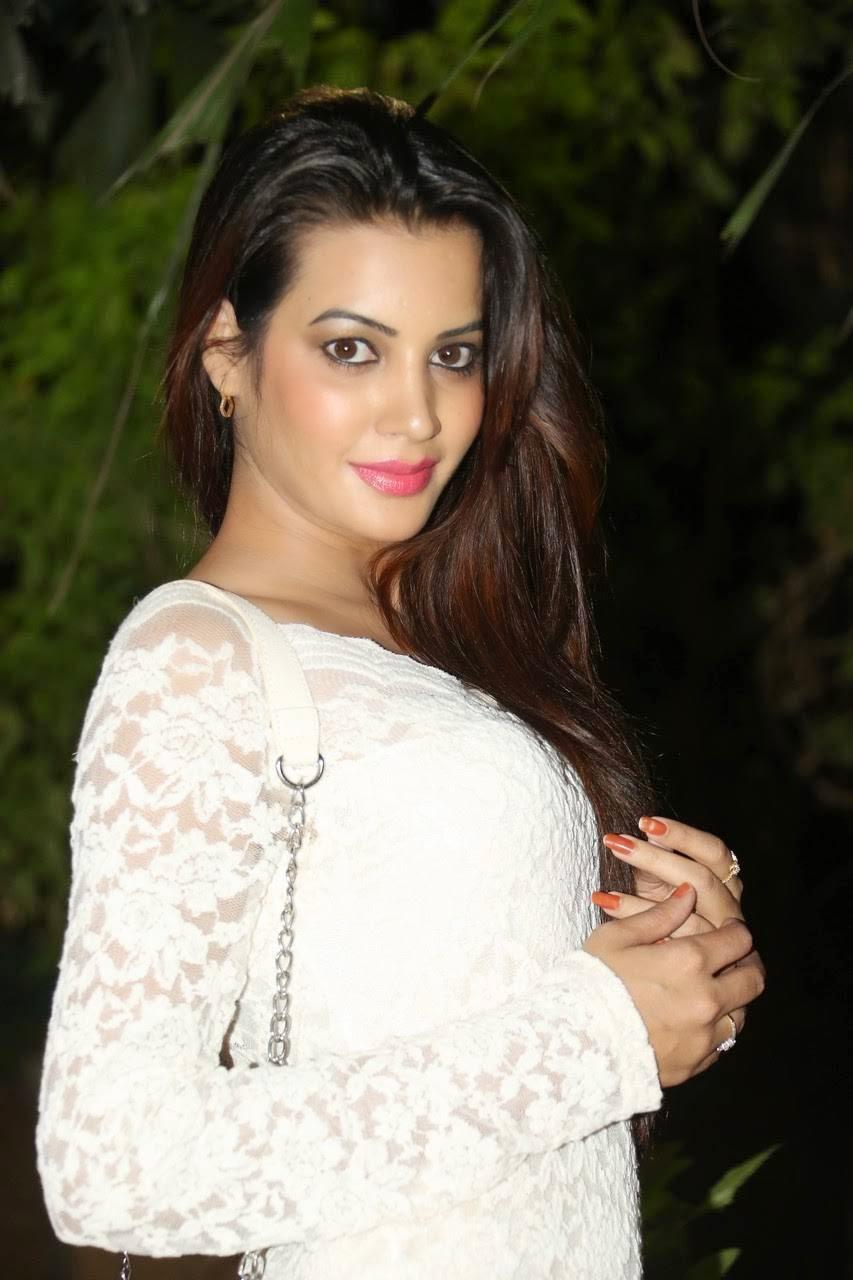 Diksha Panth Photo Gallery, Actress Diksha Panth Crossleg Sitting Pics in White Dress from Event