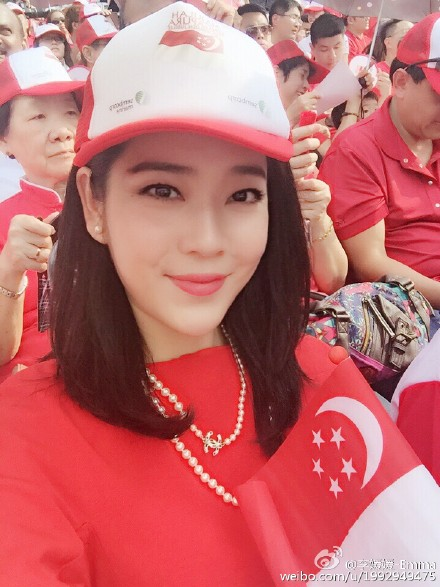 Miss Lee, a Chinese national, made waves online when she was captured on camera five times during the three-hour live telecast of Sunday's National Day Parade. A managing director of her own company, she hopes to wed a Singaporean man.
