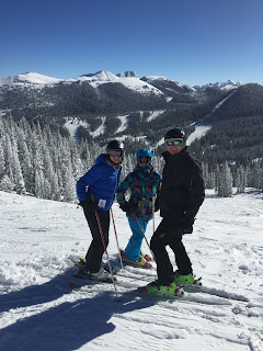 A family skiing on a sunny winter day.