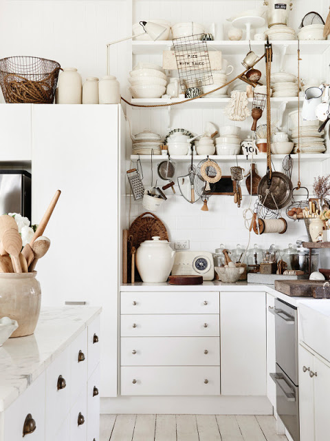 Rustic decor in a white cottage kitchen by Kara Rosenlund. #rusticdecor #kitchen #whitekitchen #vintagestyle #bohemian #farmhousekitchen