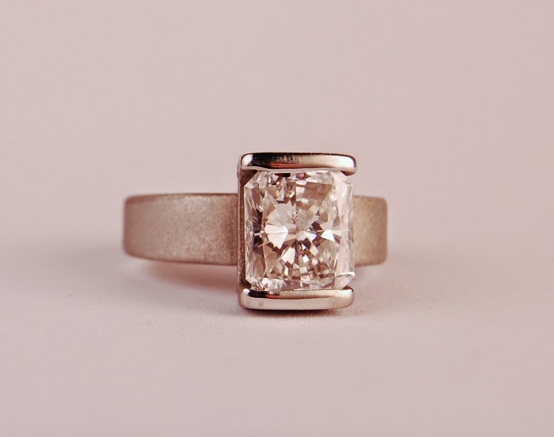 Large rectangular diamond in a simple deco like setting