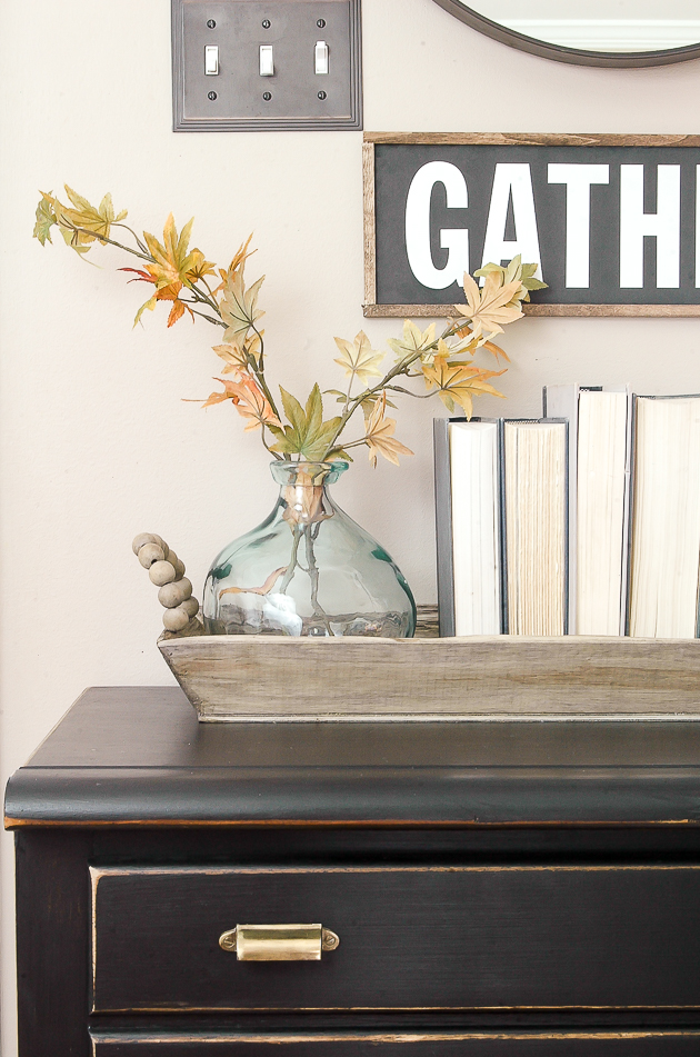 Using a wood tray to organize and ground decor