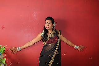Itlu Mee Saroja movie spicy stills Kanchana romancing Aryan in Saree Red Choli
