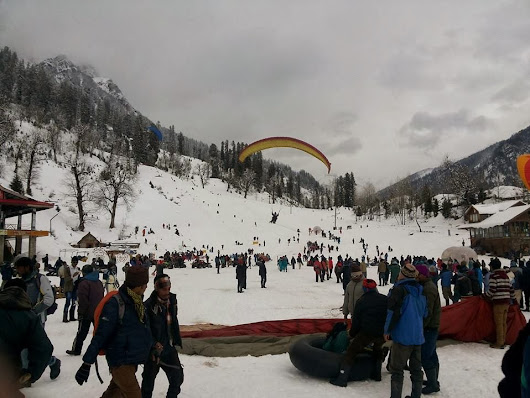 Tourists take wings in snow-covered Solang valley
