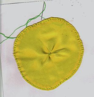 Yellow circle with stitching around edge