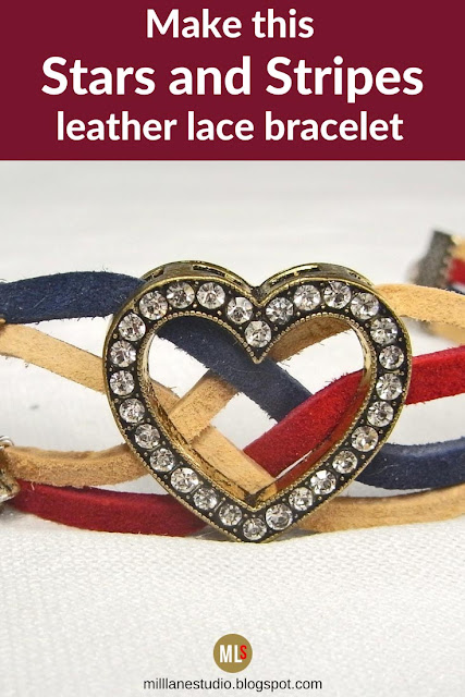 Patriotic leather lace bracelet in cranberry, sandy beach and cadet blue studded with silver star charms and featuring a crystal studded heart focal.