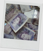 Pile of banknotes, styled as a polaroid photo