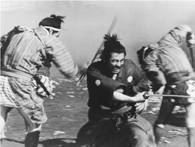 a still from yojimbo's final battle, toshiro mifune, directed by akira kurosawa