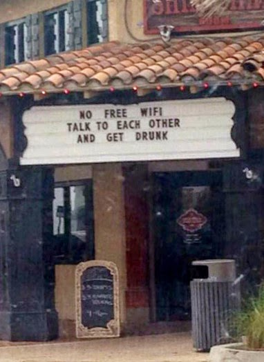 http://www.funnysigns.net/talk-to-each-other-and-get-drunk/