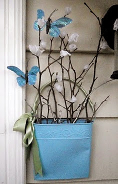nice spring decoration with blue paper butterflies on branches