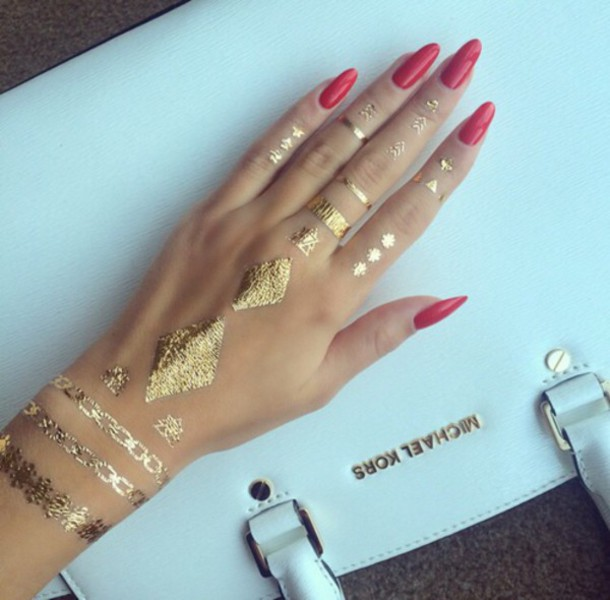 Stunning Hand Gold Tattoo