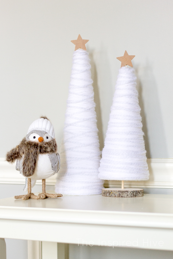DIY Winter Yarn Decorative Trees Craft | The Inspired Hive - Make these easy and affordable DIY winter yarn trees to spruce up your winter decor! A great knock off idea to get the look for less! Get the tutorial at TheInspiredHive.com!