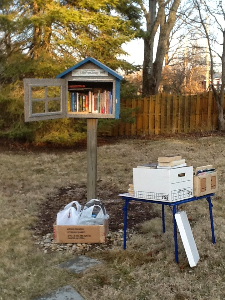 Photo of Little Free Library #6788, plus three boxes of extra books.