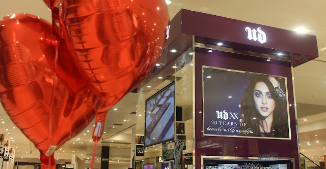 Photo of urban decay stand with heart balloons
