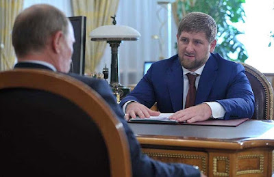 Vladimir Putin and Ramzan Kadyrov (right)
