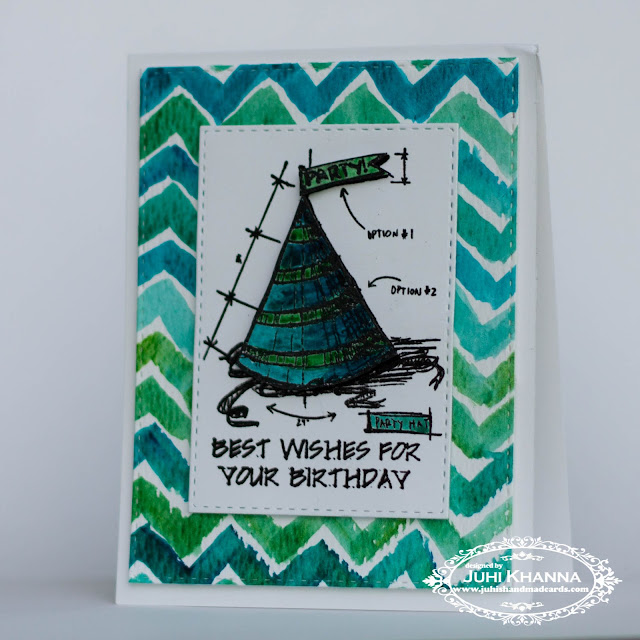 Handmade card with a handpainted watercolor chevron background and tim holtz stamps