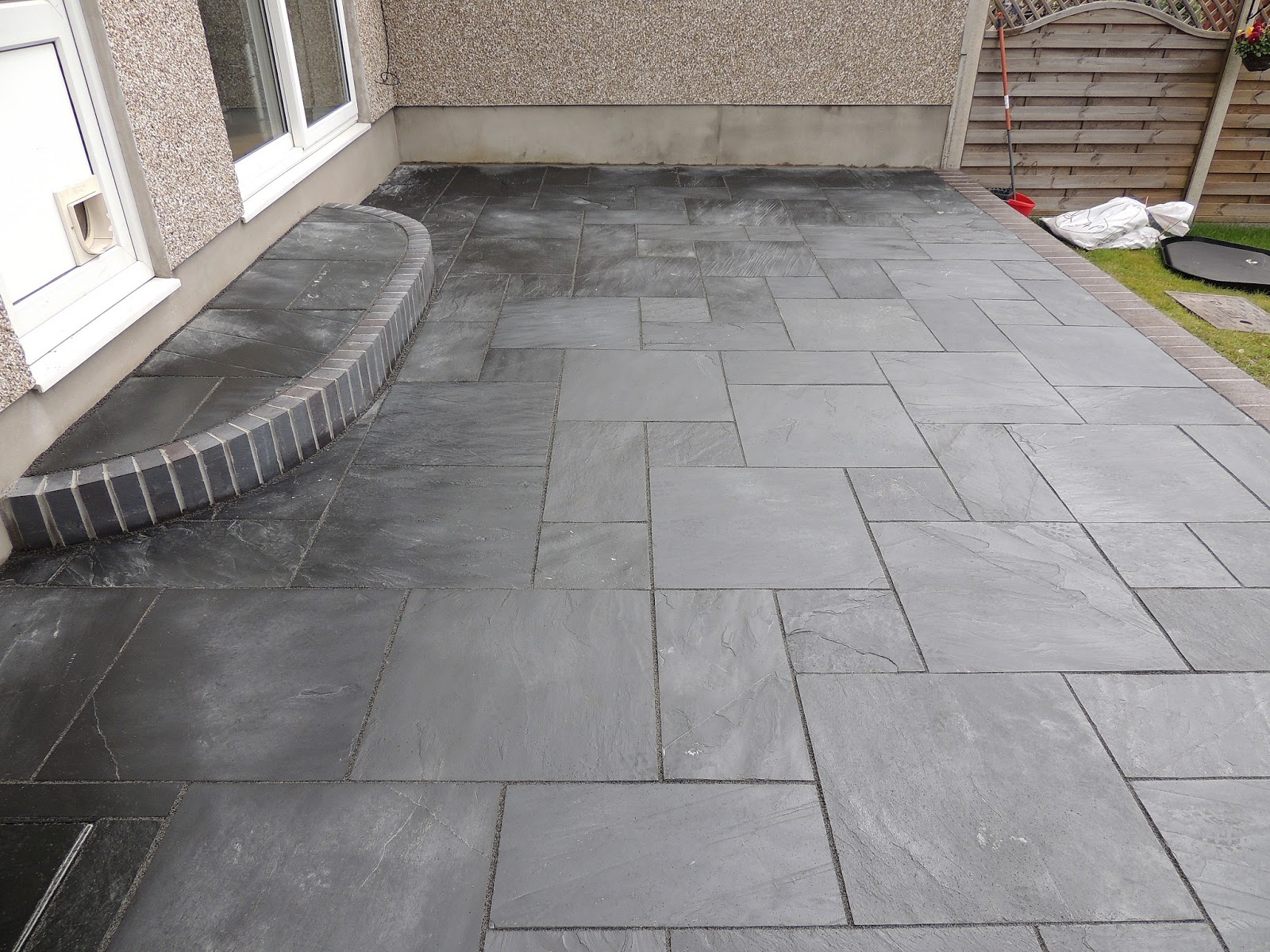 CWM LLYNFI BRICKLAYING  Carbon black slate patio