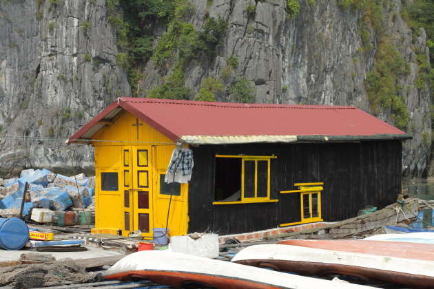 Yellow boathouse at Halong Bay, Vietnam
