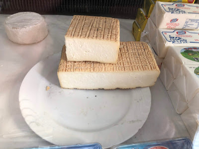 A hunk of Taleggio cheese purchased in Val Taleggio.