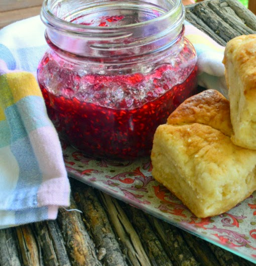 Raspberry Rose Jam is made in about 15 minutes with just 5 minutes of simmering time. I always have this in my fridge and love the extra subtle taste of rose water. I'm not a jam maker but this always works for me! #jam #raspberries #quickjam www.thisishowicook.com