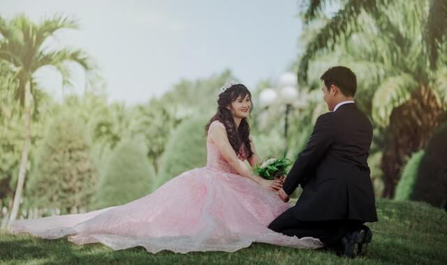 Couple-Sitting-on-Grass-HD-Copyright-Free-Image