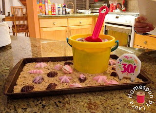 beach cake with sand bucket