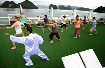 Morning Tai Chi Exercise on Halong bay cruise