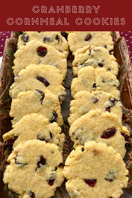 Cornmeal cookies filled with sweet and tart dried cranberries and rolled in sugar are a childhood holiday favorite. These cookies are simple, rustic, unique, and yummy!