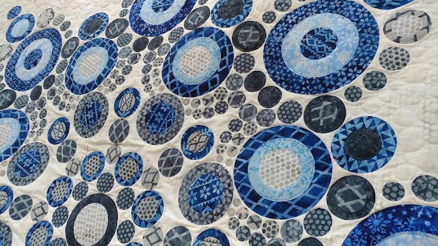 Modern snowflake quilt using Island Batik Alpine Ice fabrics