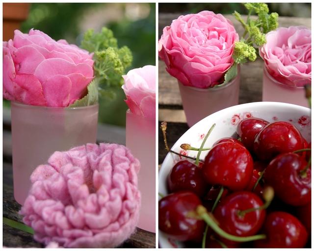 gefilzte Nelke und Rosenblüten im Glas dekoriert