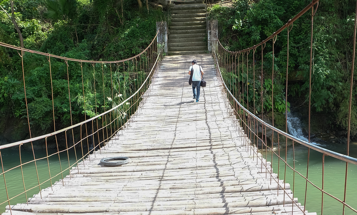 Crossing the hanging bridge in search for the oldest pottery maker in Iloilo