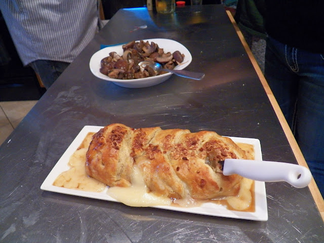 Baked Brie with Currant Jelly and Nuts in Puff Pastry