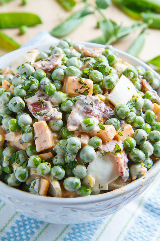 In a colander, drain peas very well. Place drained peas in a medium bowl. Add the onions, crumbled eggs, and mayonnaise, tossing to combine and coat peas. Season to taste with salt and pepper. Add.