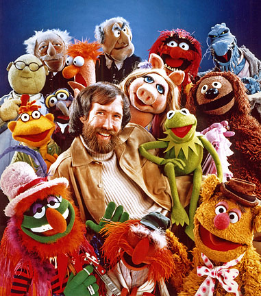 Jim Henson surrounded by over a dozen of the best-known Muppets