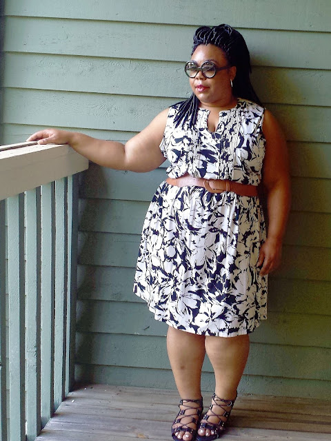 Black and white floral dress, lace up gladiators, half tinted lens sunglasses