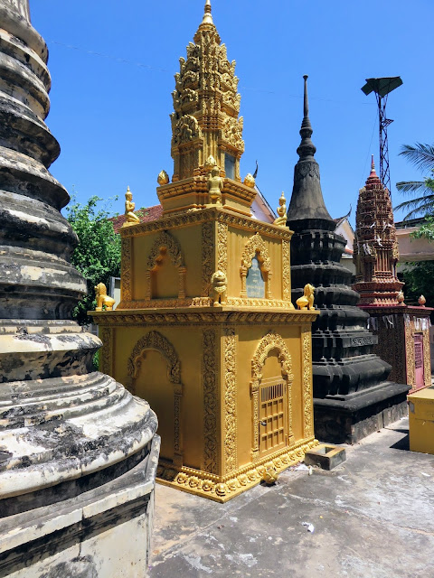 Golden monuments at Wat Damnak in Siem Reap Cambodia